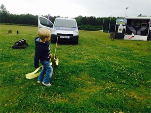 THE BOLNORE FUNDRAISER IN MEMORY OF JOEL DEVALDA - A young boy tries to pull the BSW van